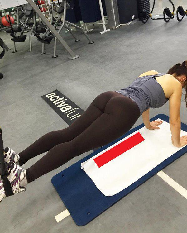 Girl in yoga pants working out can