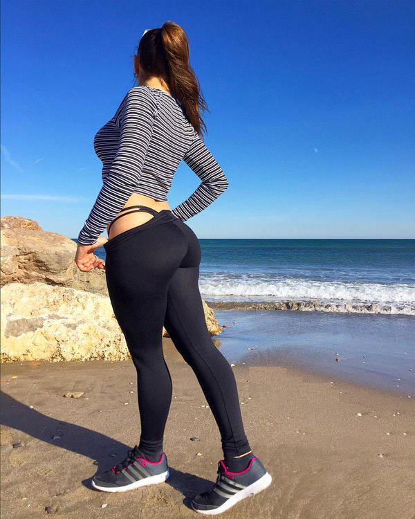 Showing off her thong on the beach - GirlsInYogaPants.com