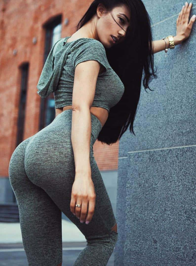 Hot girl in bright black yoga pants nothing tell