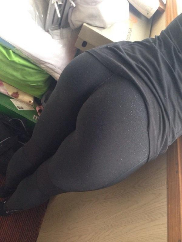 tight black yoga pants bent over